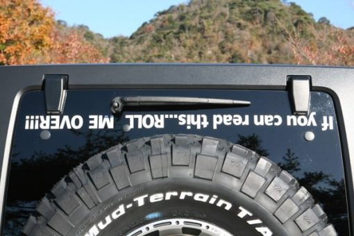 If you can read this roll me over decal - https://customstickershop.us/product-category/windshield-decals/